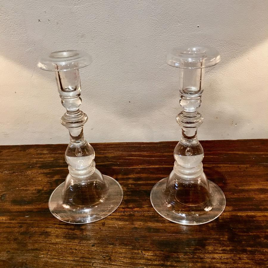 A pair of glass candle sticks