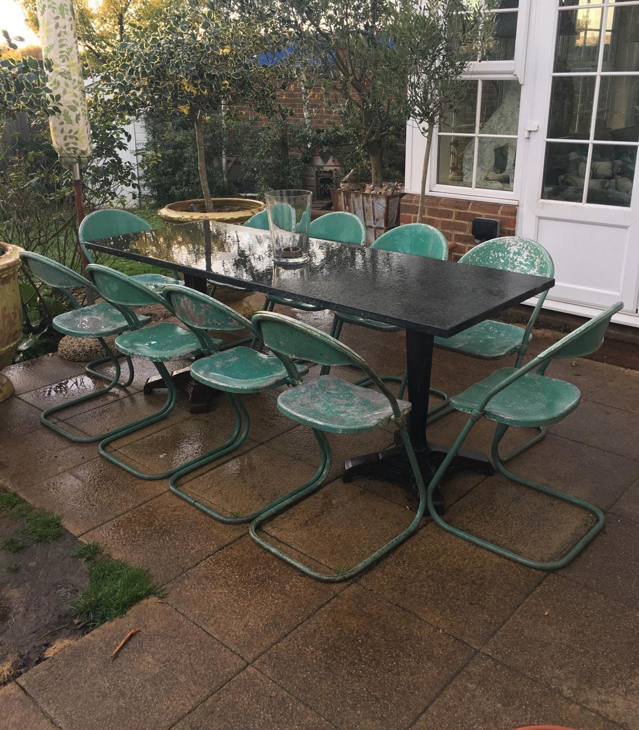 A set of 12 Aluminium cafe chairs