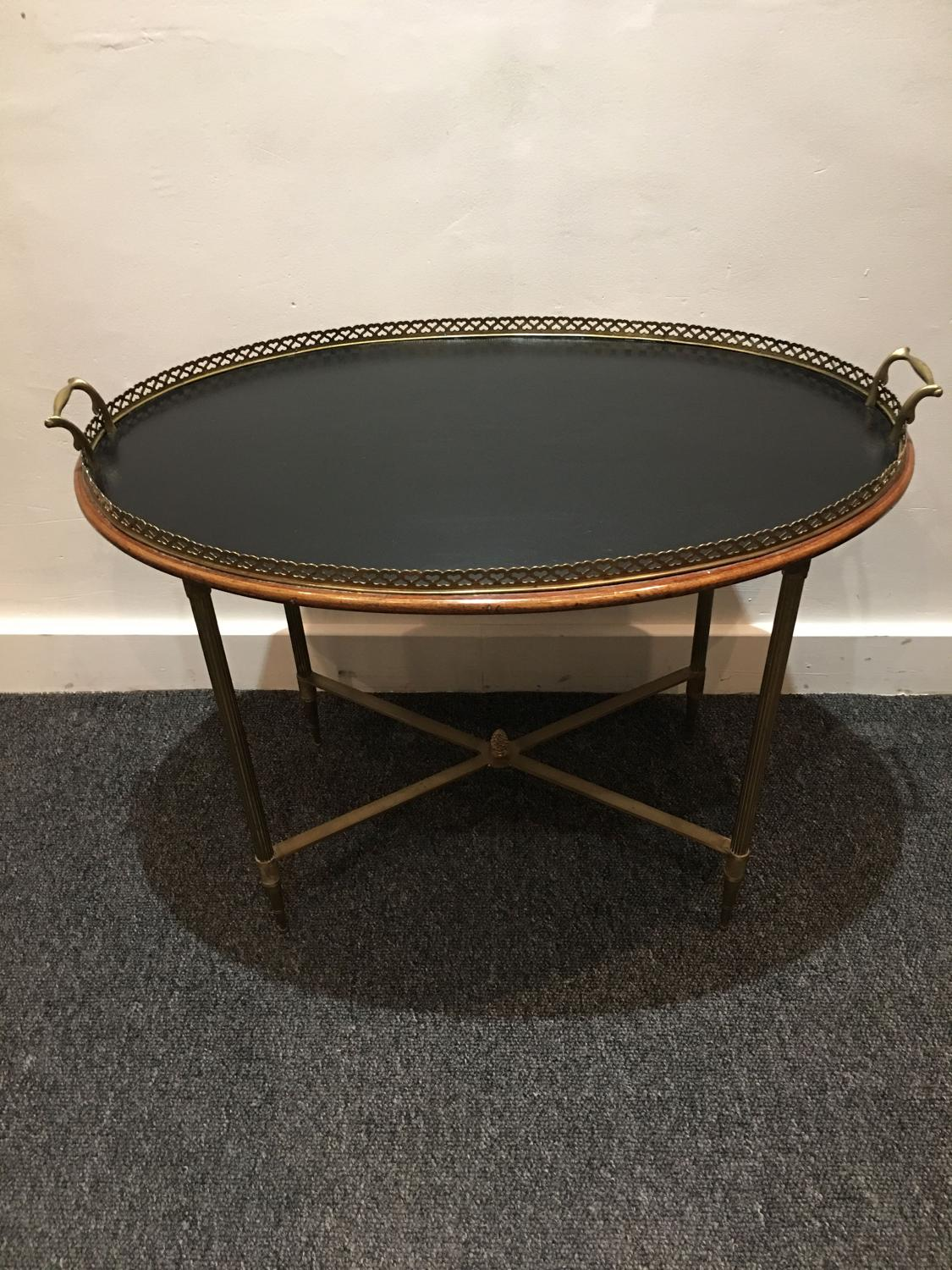 A brass fixed tray table