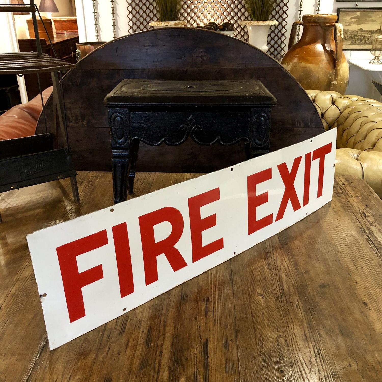 An Enamel fire exit sign