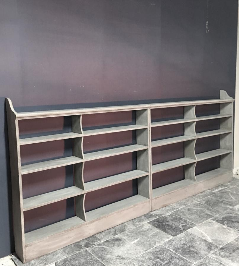 A run of open bookshelves