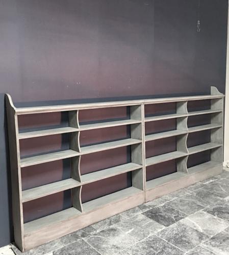 A run of open bookshelves