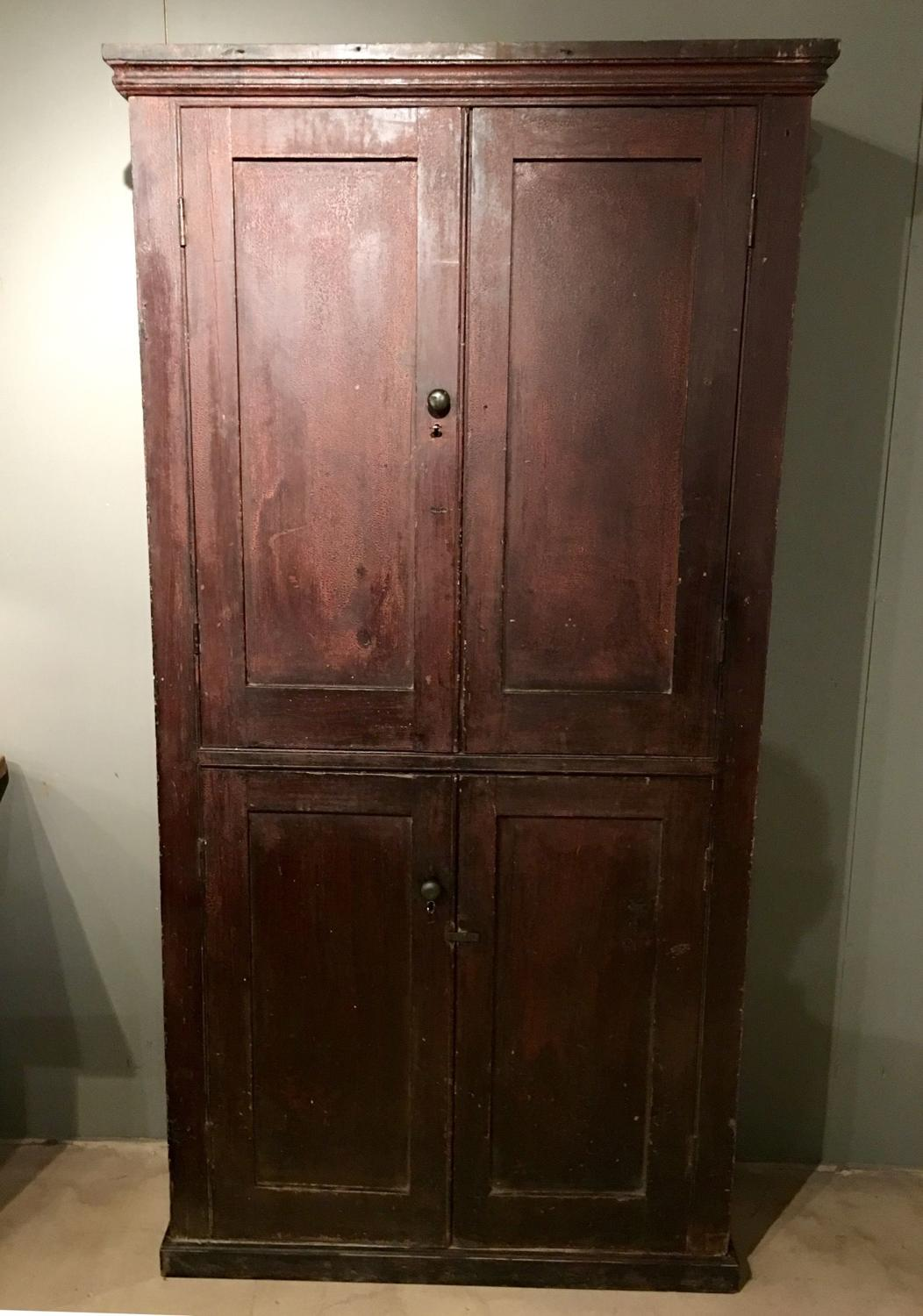 A petite Georgian house keepers cupboard