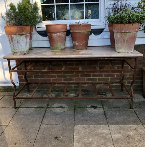 A wrought iron island table
