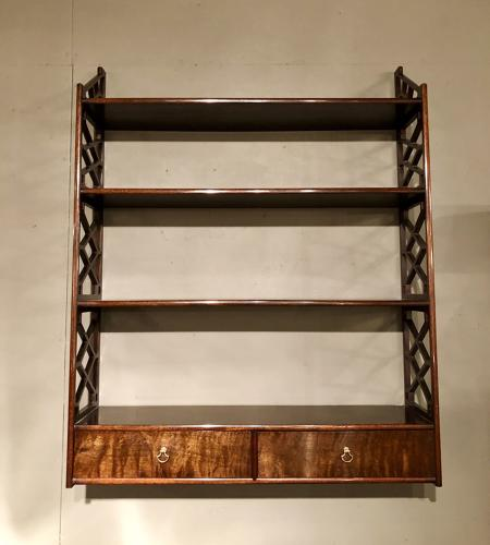 A pair of Chinese Chippendale hanging shelves