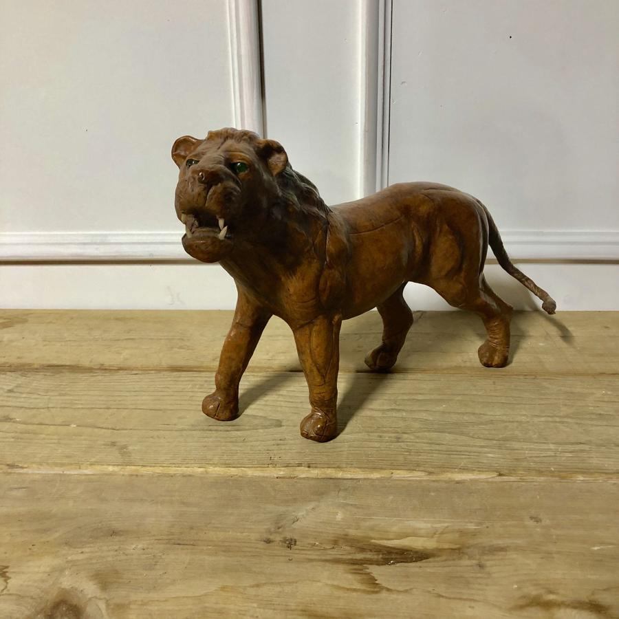 A leather and papier-mache lion