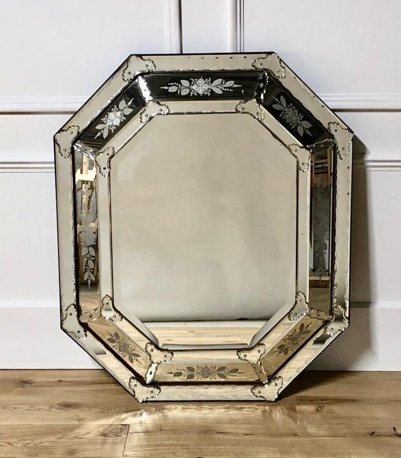 A large cushion Venetian Mirror