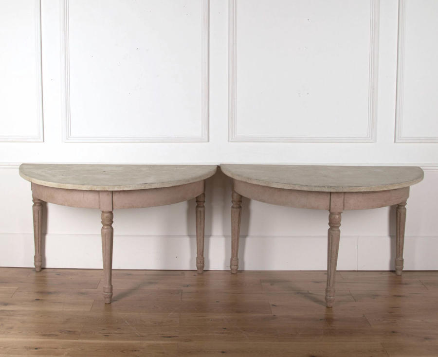 A pair of Painted Demi Lune Tables