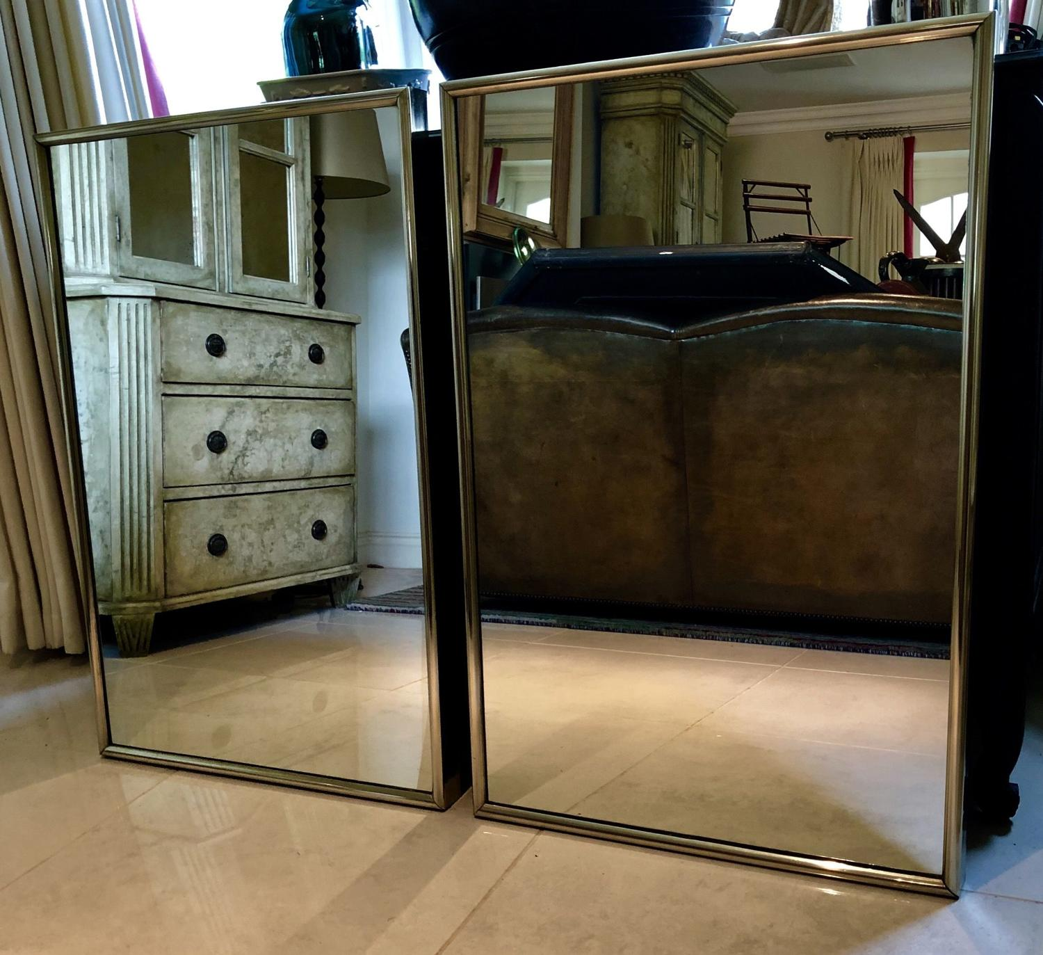 A pair of Bronze Framed shop mirrors