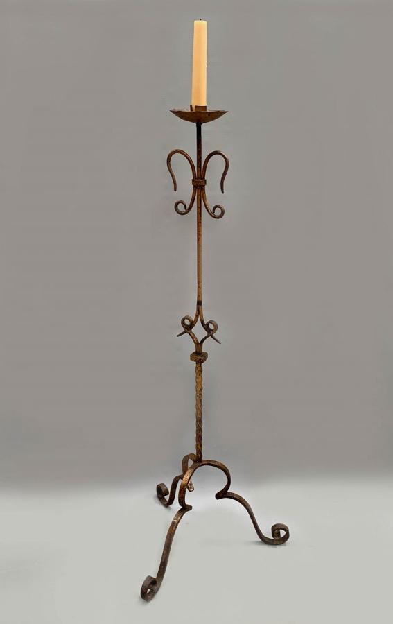 A Spanish gilt metal altar candle stand