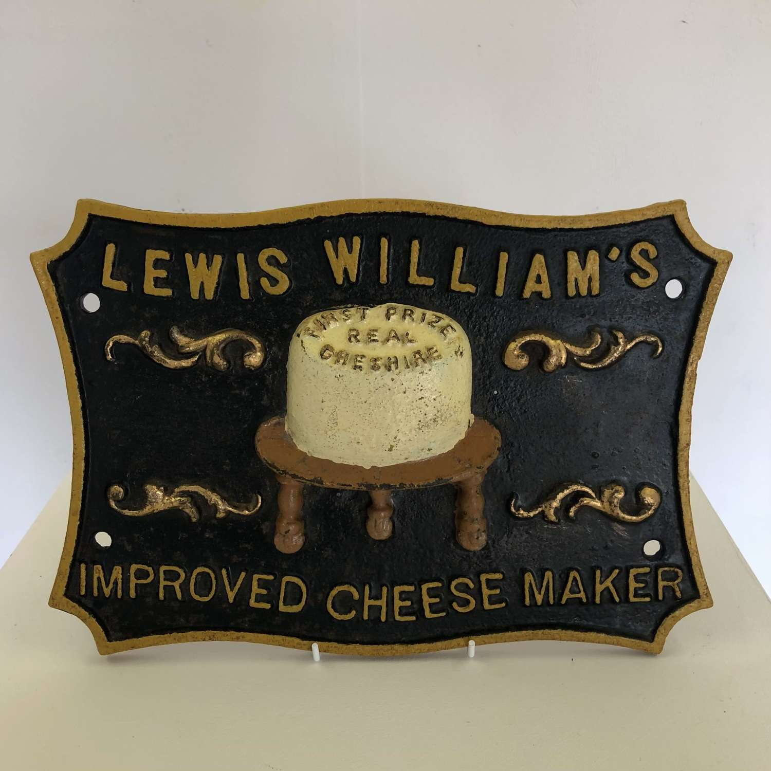 A cast iron Cheese plaque