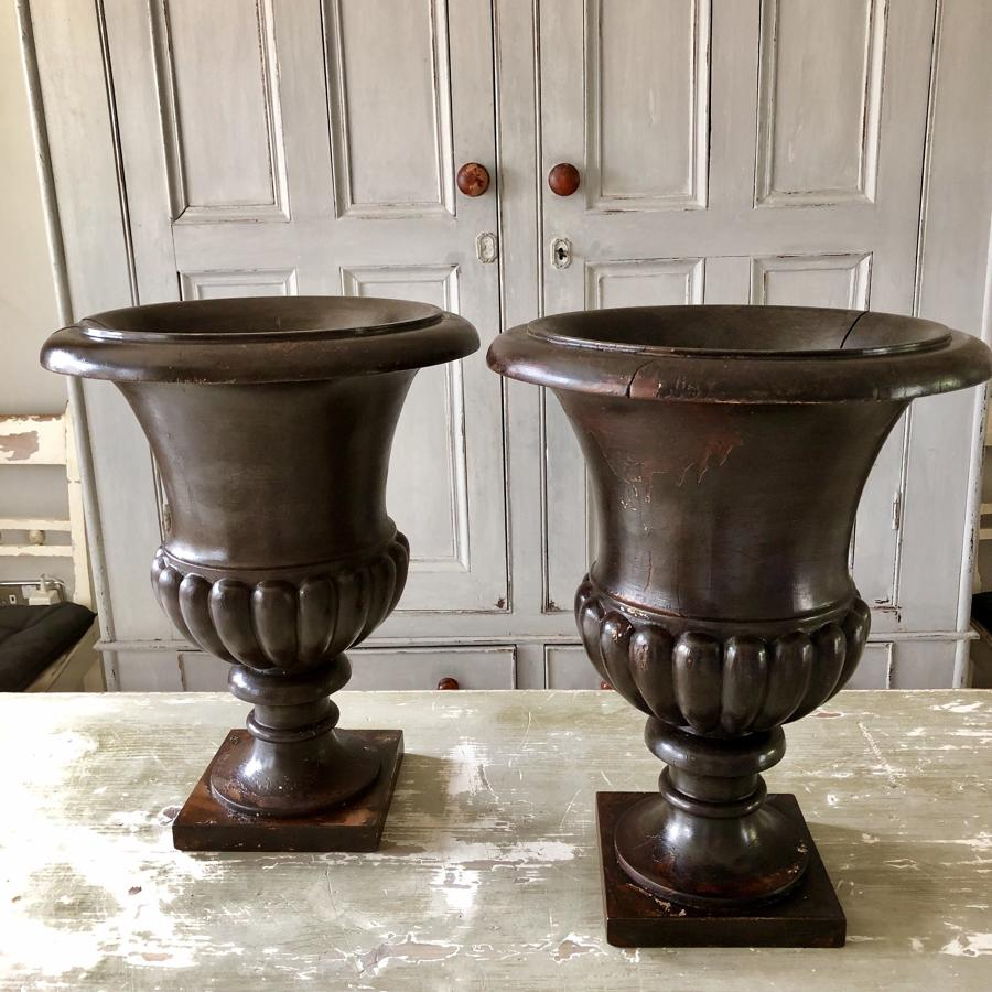 A pair of Turned and carved wood urns