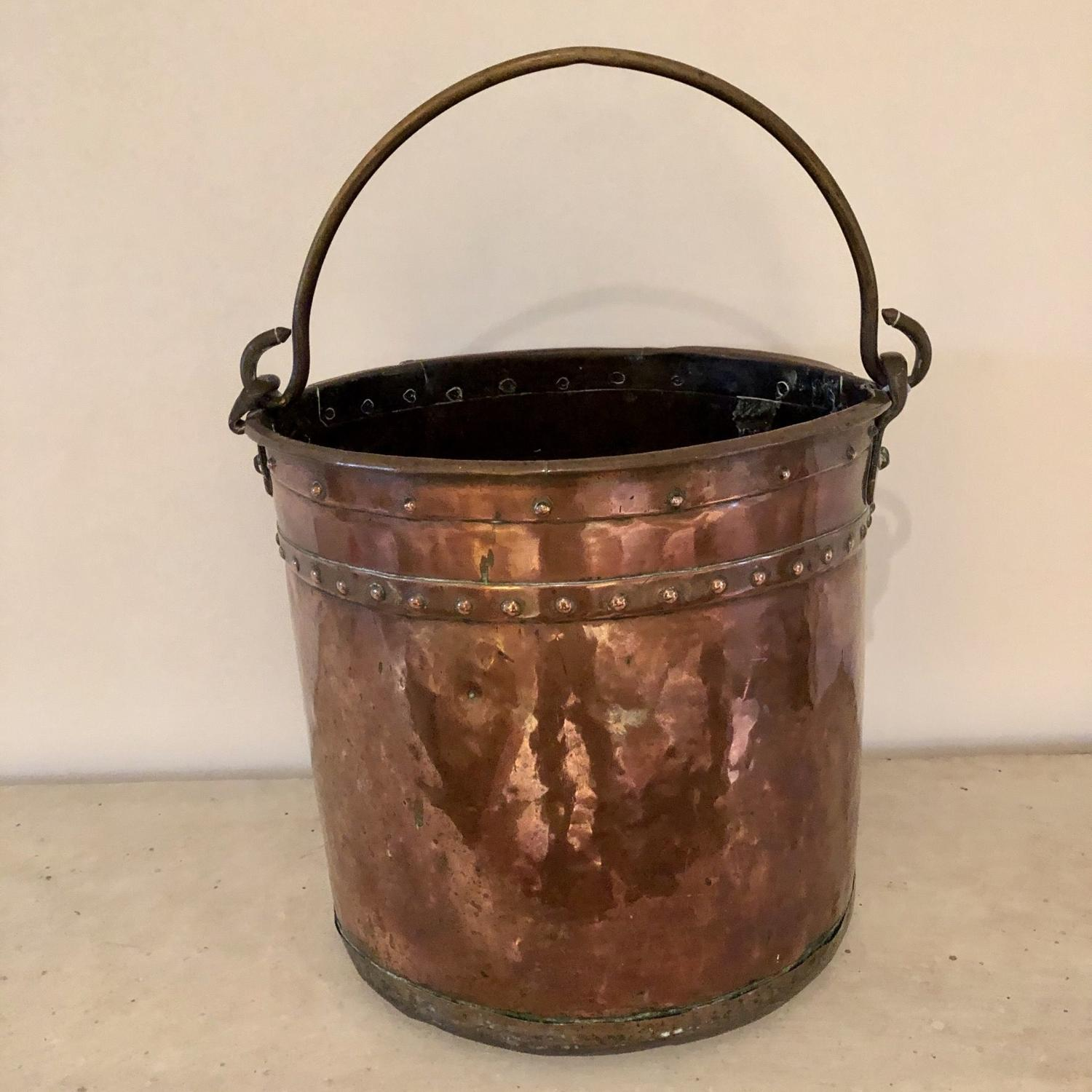 A copper and brass coal bucket