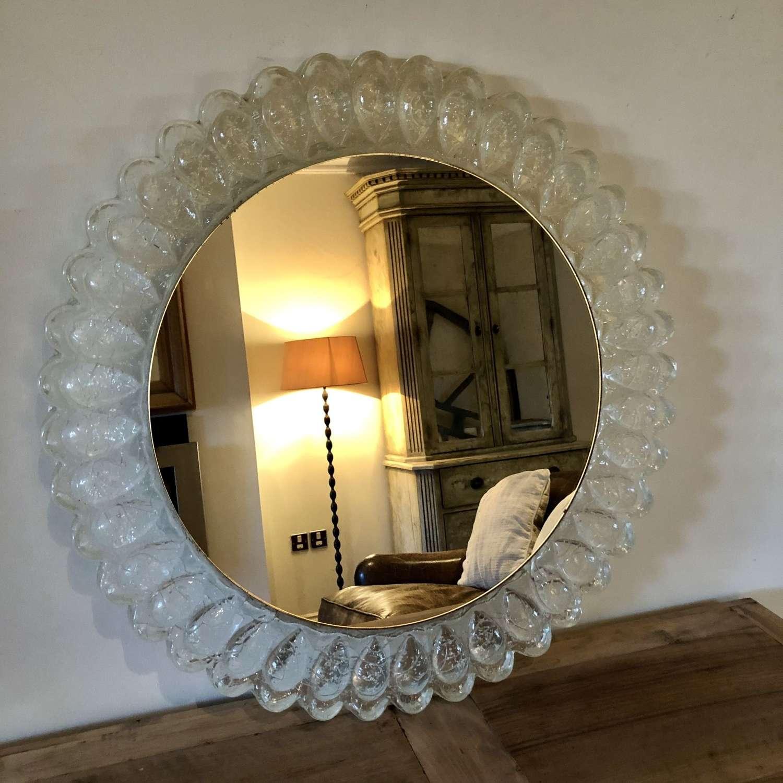 A circular lucite mirror