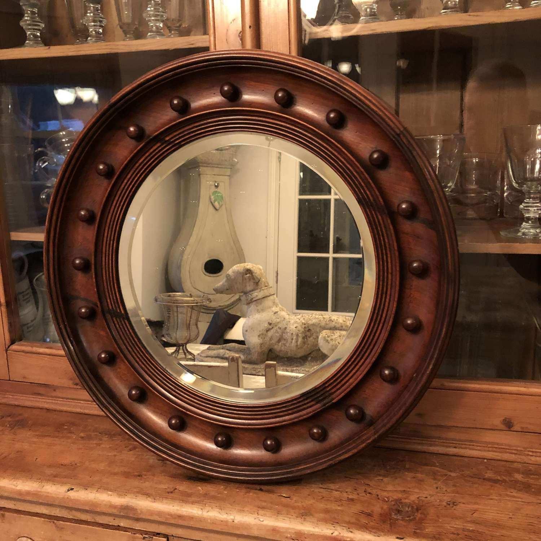 A circular Regency style mirror