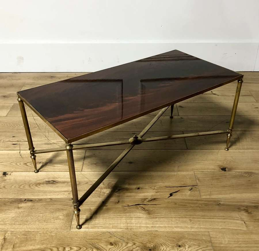A brass a mahogany coffee table