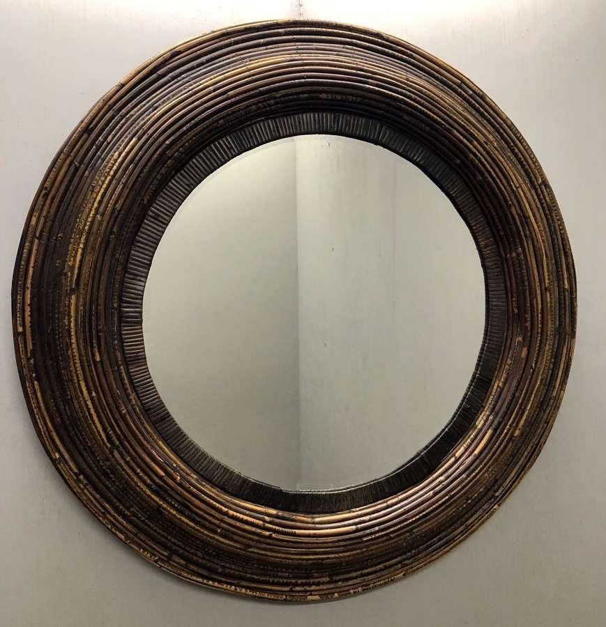 A bamboo cane circular mirror