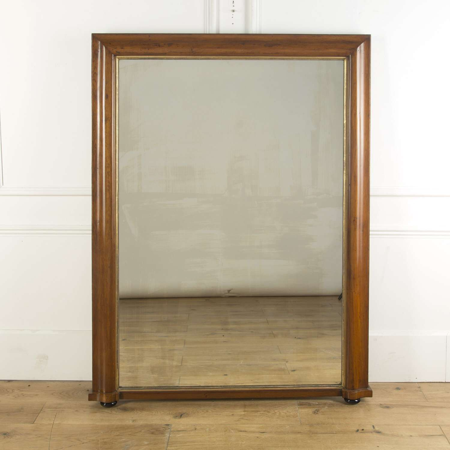 A large over mantle mirror