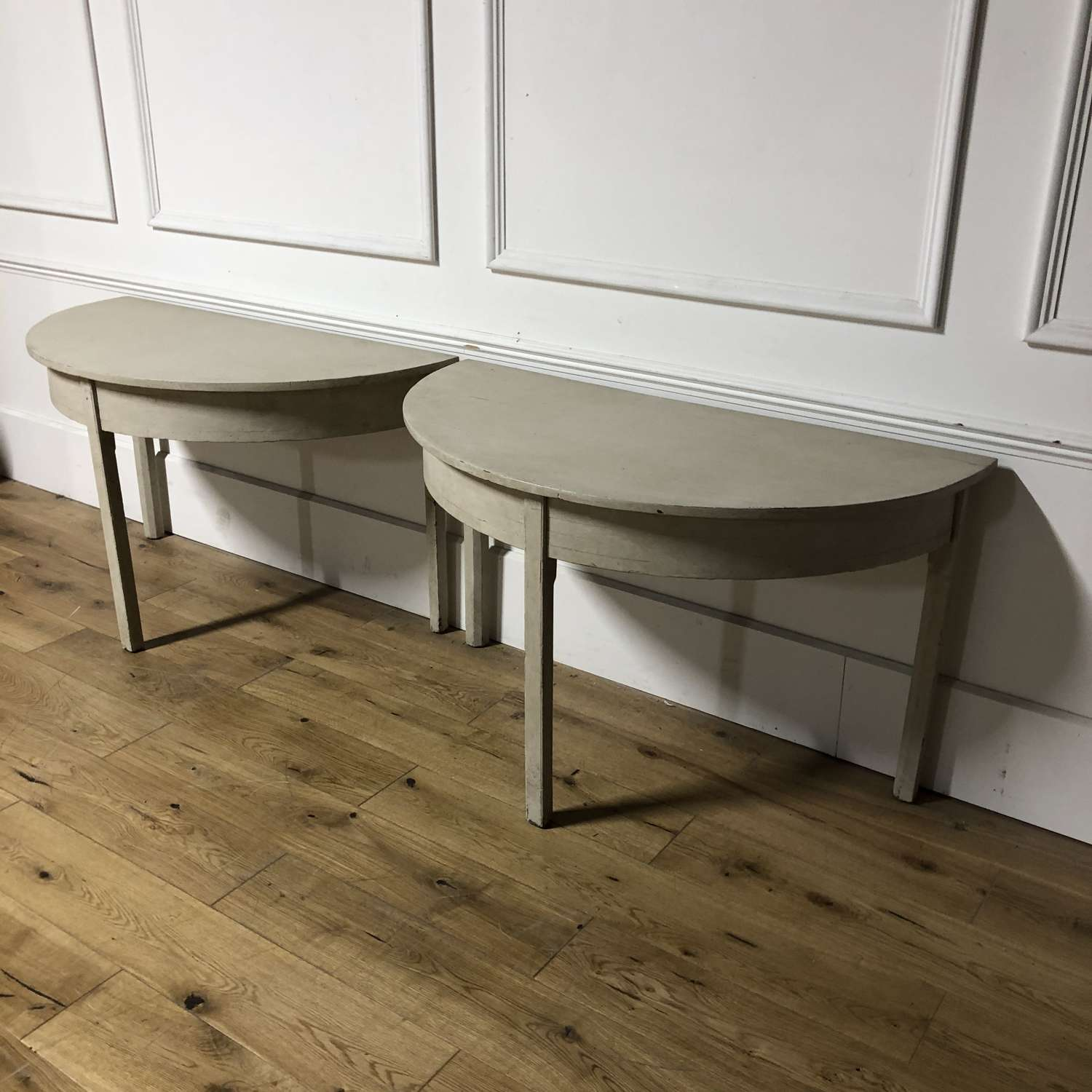 A Pair of Demi Lune Tables