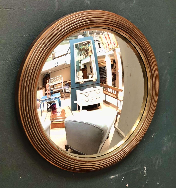 A brass bound convex mirror