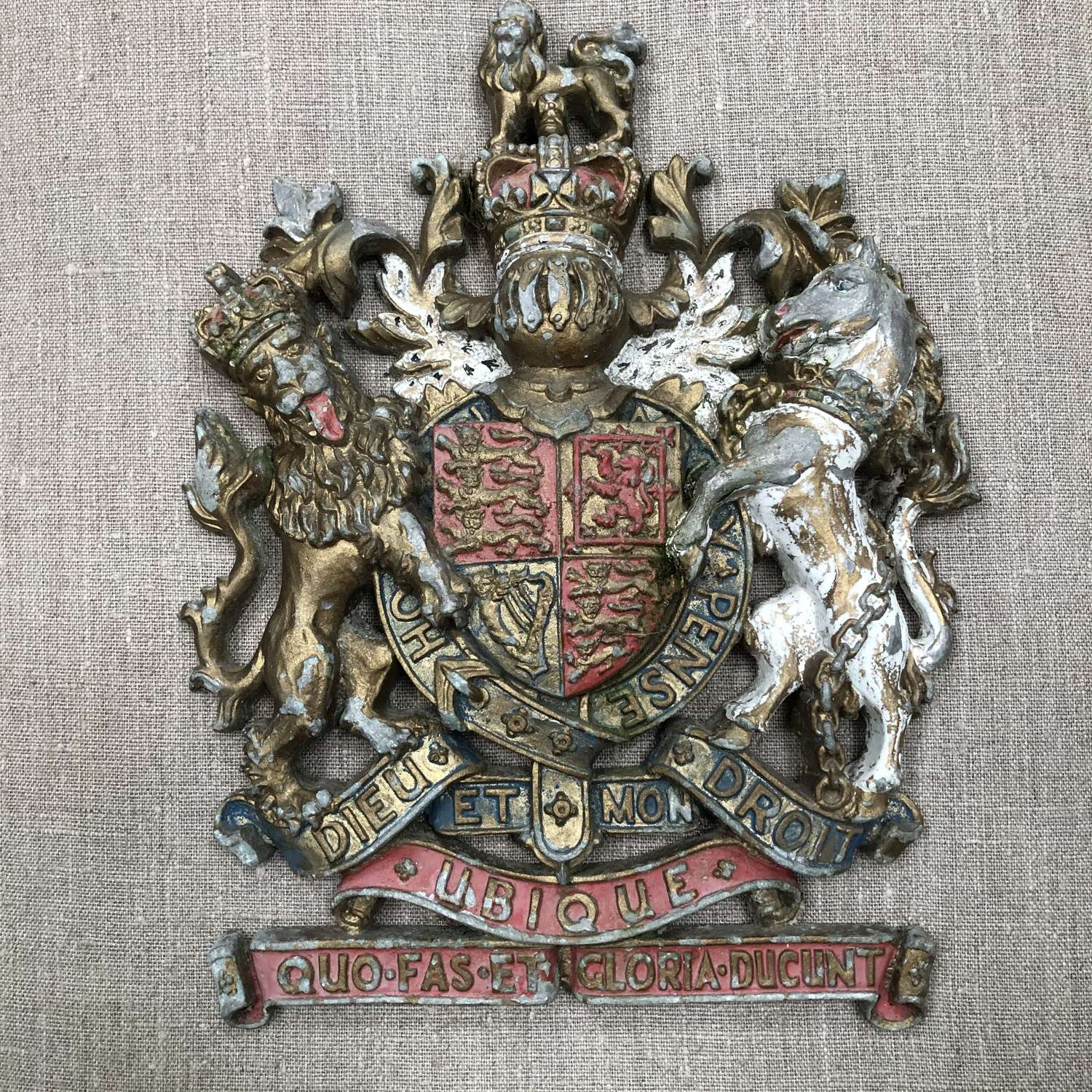 A cast metal coat of arms