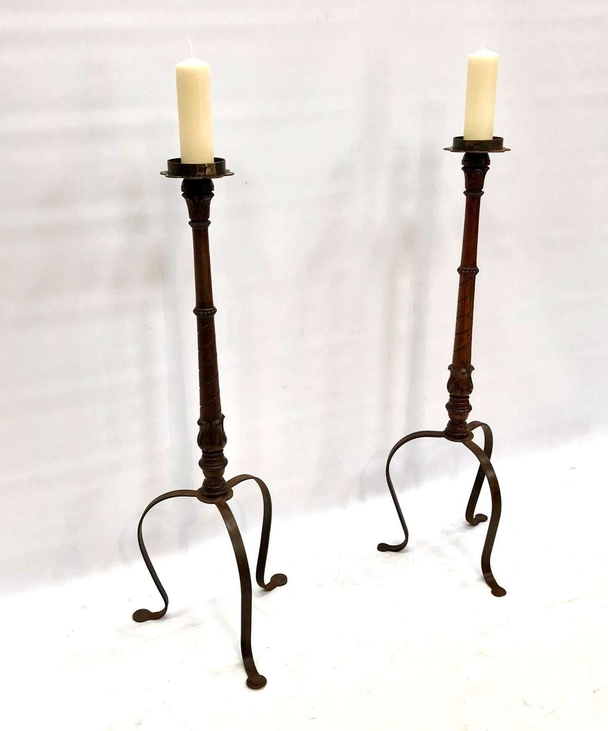 A pair of ecclesiastic candle stands