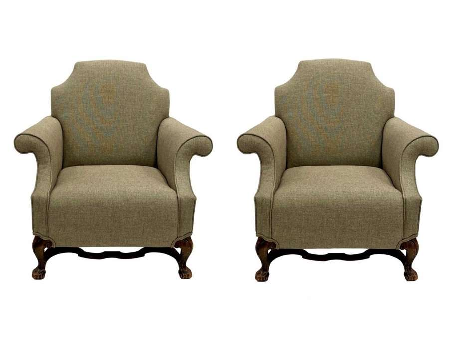 A pair of English country house armchairs