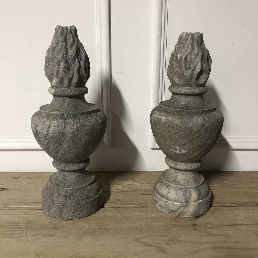 A pair of granite flambe gate post finials