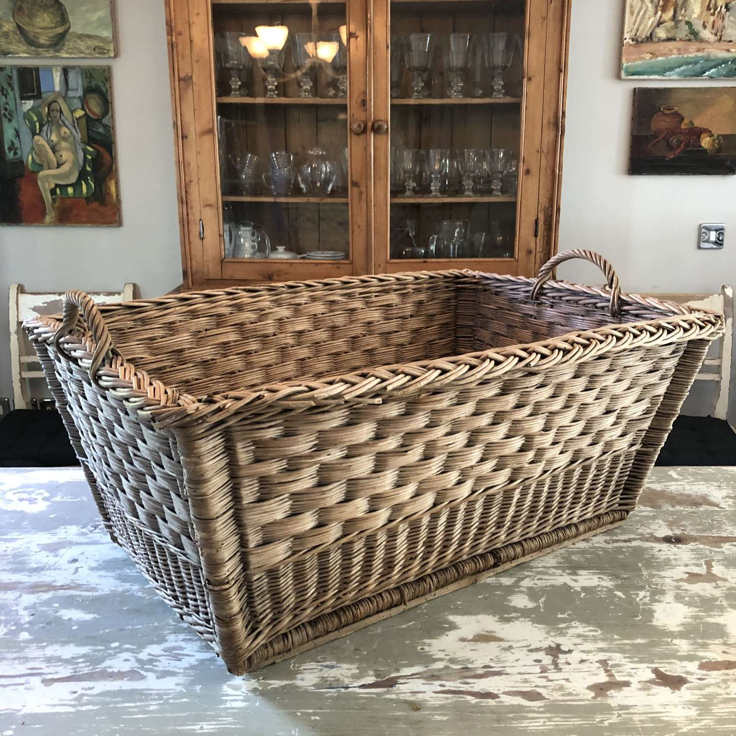 A decorative wicker log basket