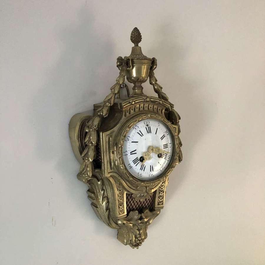 A Gilt Bronze Cartel Clock