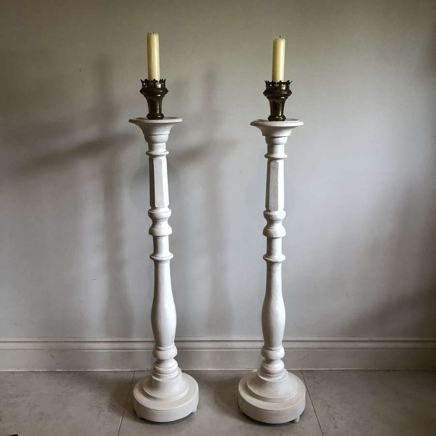 A pair of large candle sticks