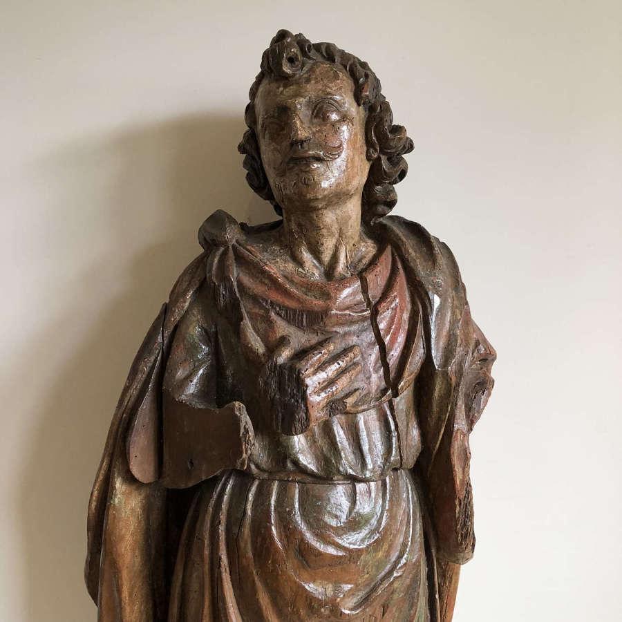 A carved lime wood figure of a saint