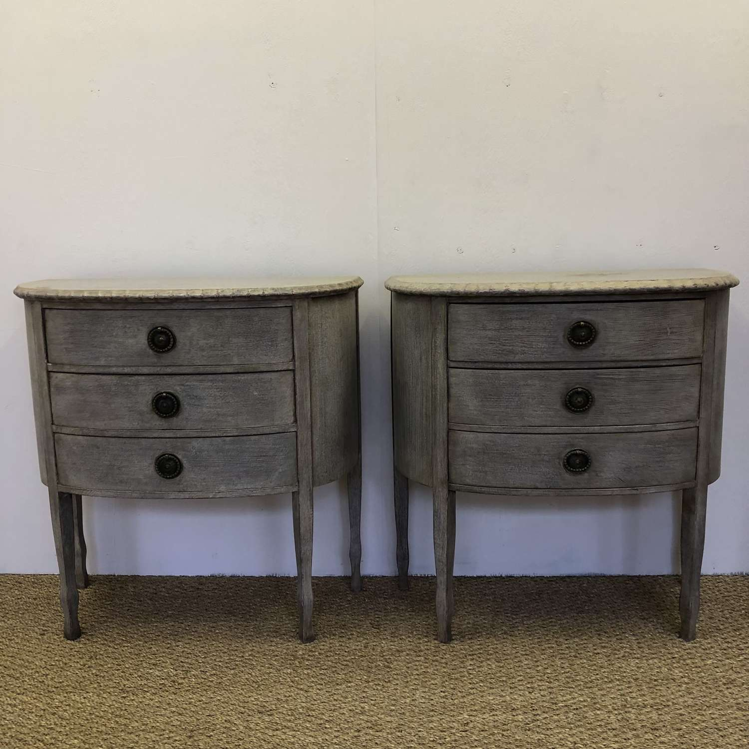 A pair of Demi Lune Commodes